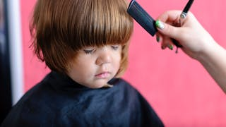 première coupe de cheveux