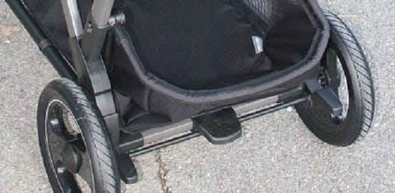 Poussette double Duette Piroet de Peg-Pérego - frein parking stationnement pied