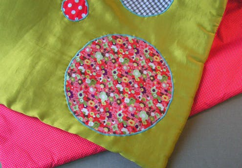 Plaid/tapis molletonné bicolore