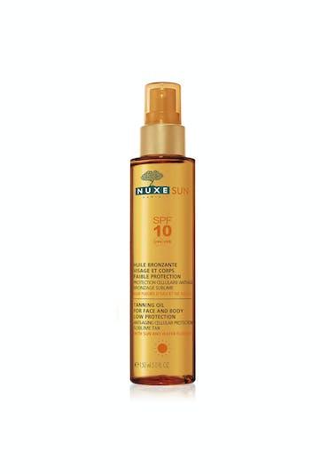 Palmarès crèmes solaires : Nuxe Sun, huile bronzante         visage et corps faible protection SPF 10