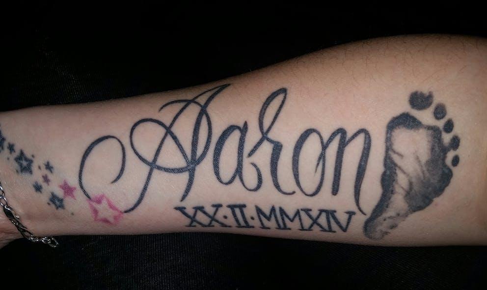 Le tatouage d'Elodie pour Aaron