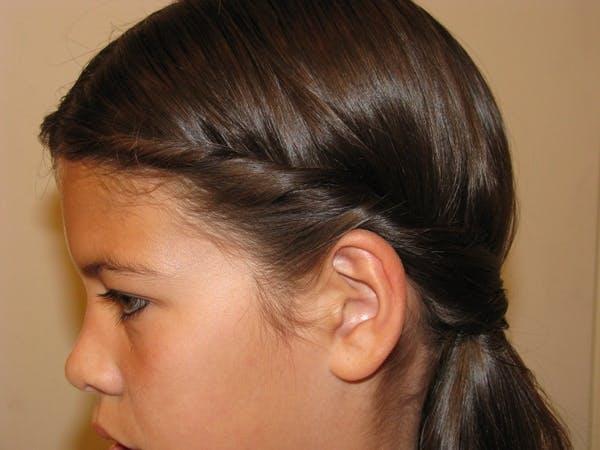 Coiffure petite fille : cheveux enroulés