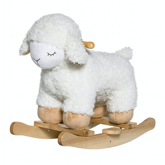 Mouton à bascule, Bloomingville Mini en exclu au         Printemps, 90 €. Dès 18 mois.