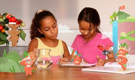 Botaki sensibilise les enfants à la nature et au jardinage, avec un jeu qui mixe réel et virtuel.
