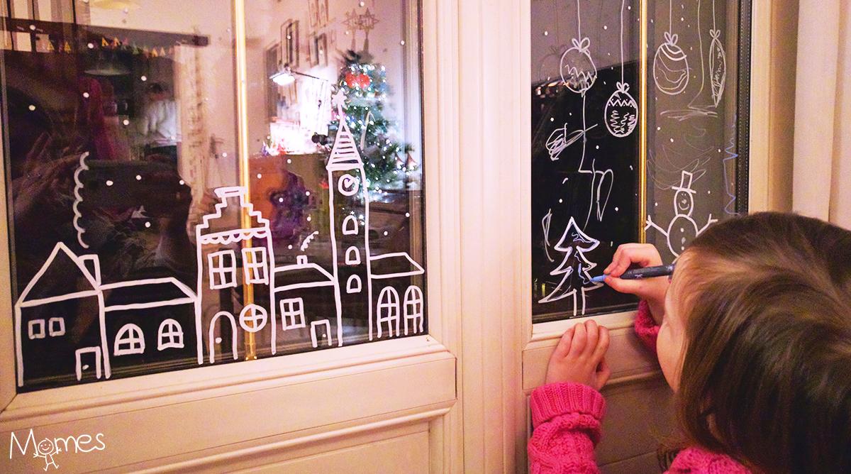 Dessiner des décorations de noël sur les vitres de la maison momes net