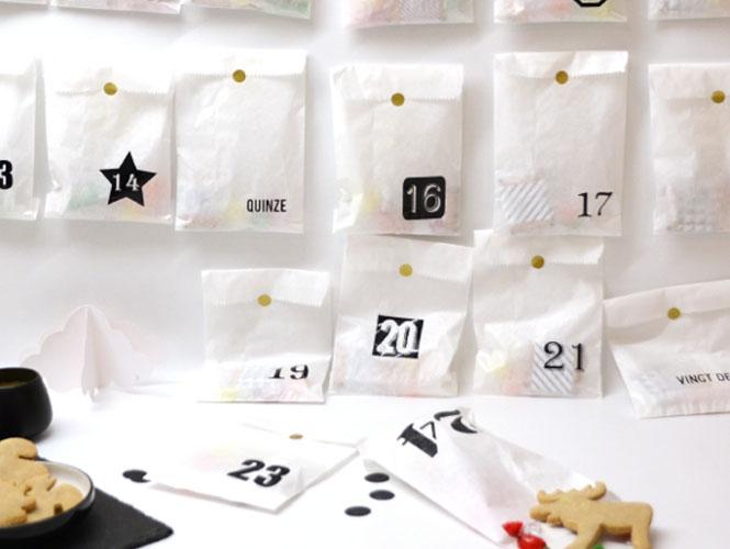 Le calendrier de l'Avent avec des pochettes en papier