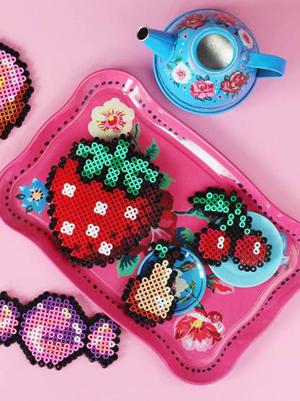 Une fraise en perles chauffantes